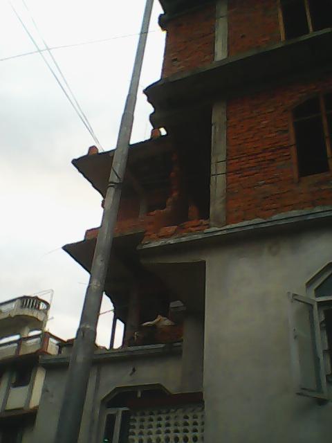 Earthquake destroyed our neighbor's house